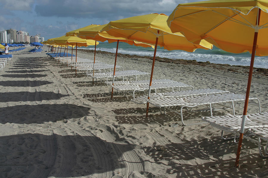 Yellow Umbrellas In South Beach Photograph by Theresemck