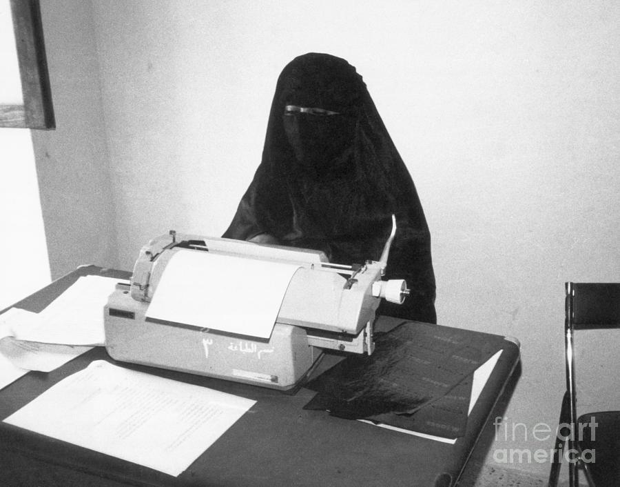 Yemeni Woman Typing In Chador And Veil Photograph by Bettmann