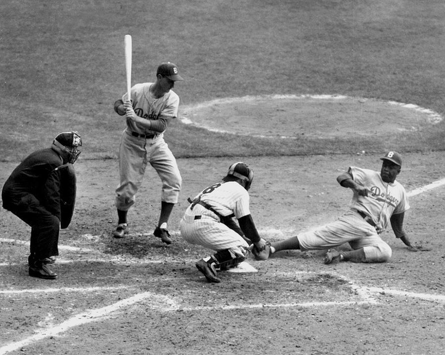 Yogi Has It Out. Jackie Robinson, With Photograph by New York Daily News Archive