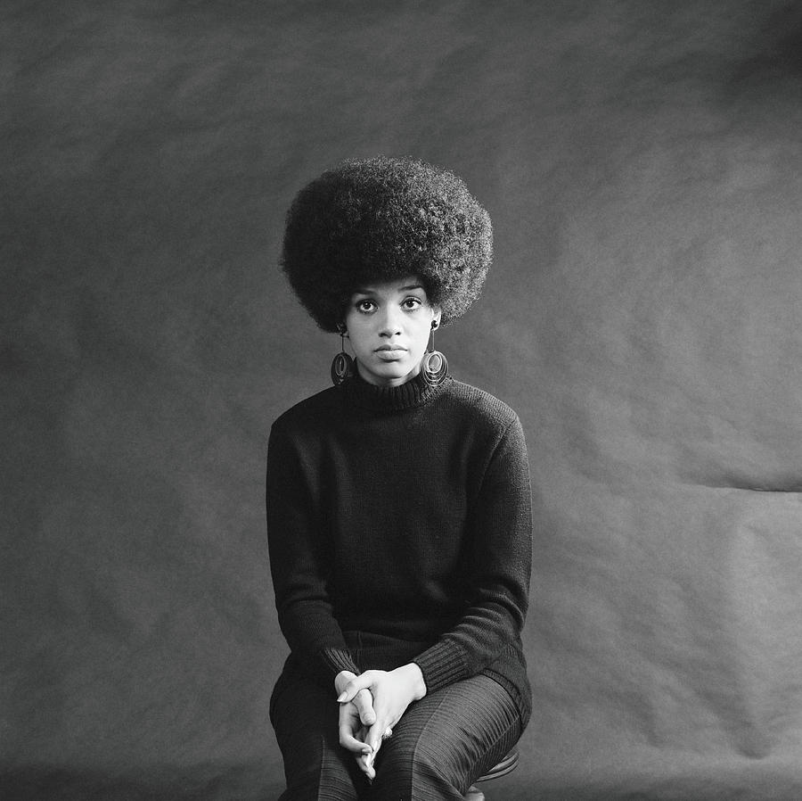 Young African-american Woman With Afro Photograph by H. Armstrong Roberts