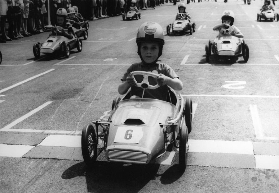 Young Boys Driving Racing Pedal Cars Photograph by Keystone-france