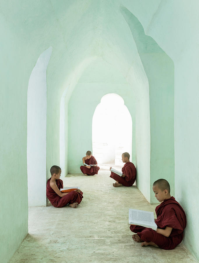 Young Buddhist Monks Reading In Temple Photograph by Martin Puddy