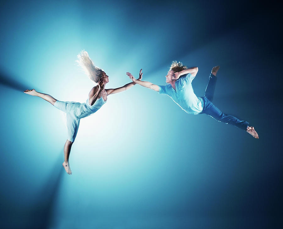 Young Men Photograph - Young Couple In Air, Low Angle View by Henrik Sorensen
