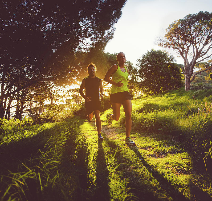 Young Couple Jogging Photograph by Wundervisuals