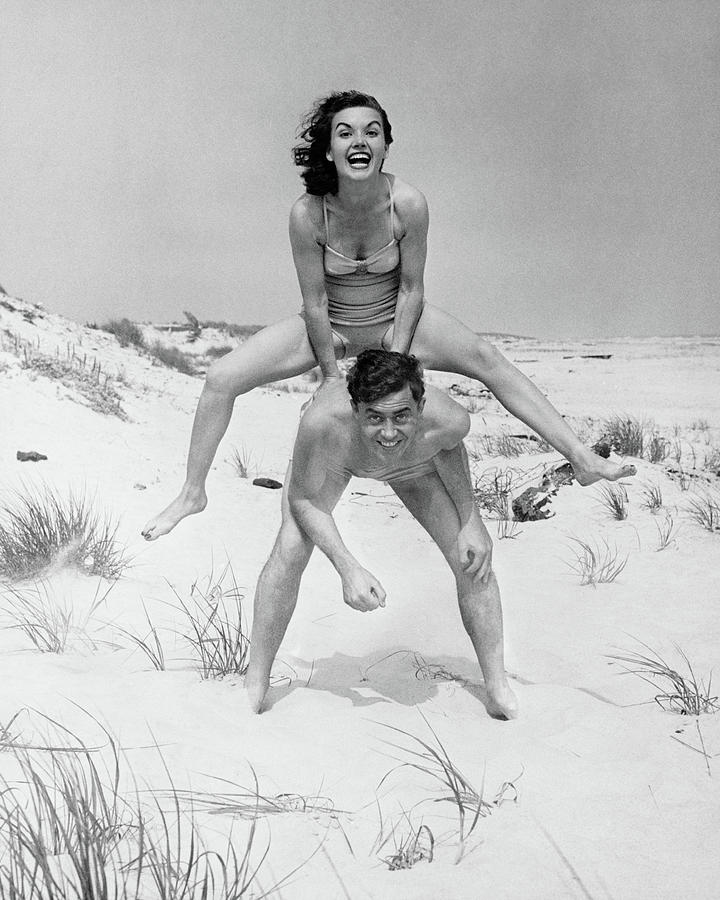 Young Couple On Beach, Woman Photograph by George Marks