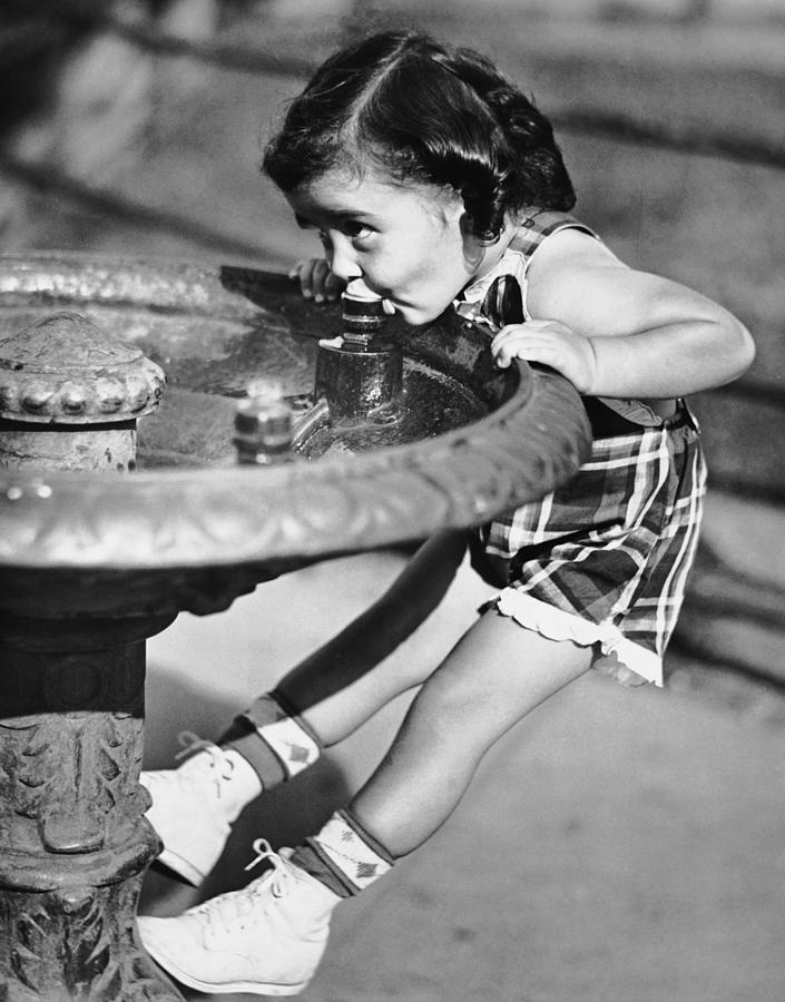 Young Girl Drinking From Water Fountain Photograph by George Marks