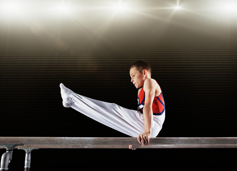 Young Male Gymnast Performing On Photograph by Robert Decelis Ltd
