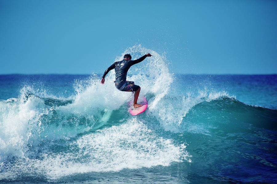 Young Male Surfer Surfing In The Water Photograph by Yinyang