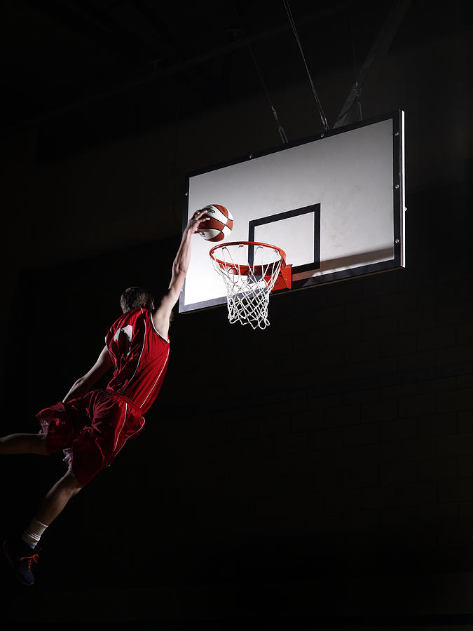 Young Man Attempting To Dunk The Photograph by Compassionate Eye Foundation/steve Coleman/ojo Images Ltd