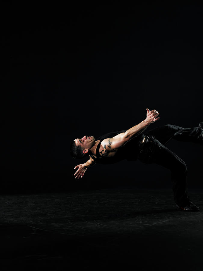 Young Man Breakdancing, Side View Photograph by Thomas Barwick