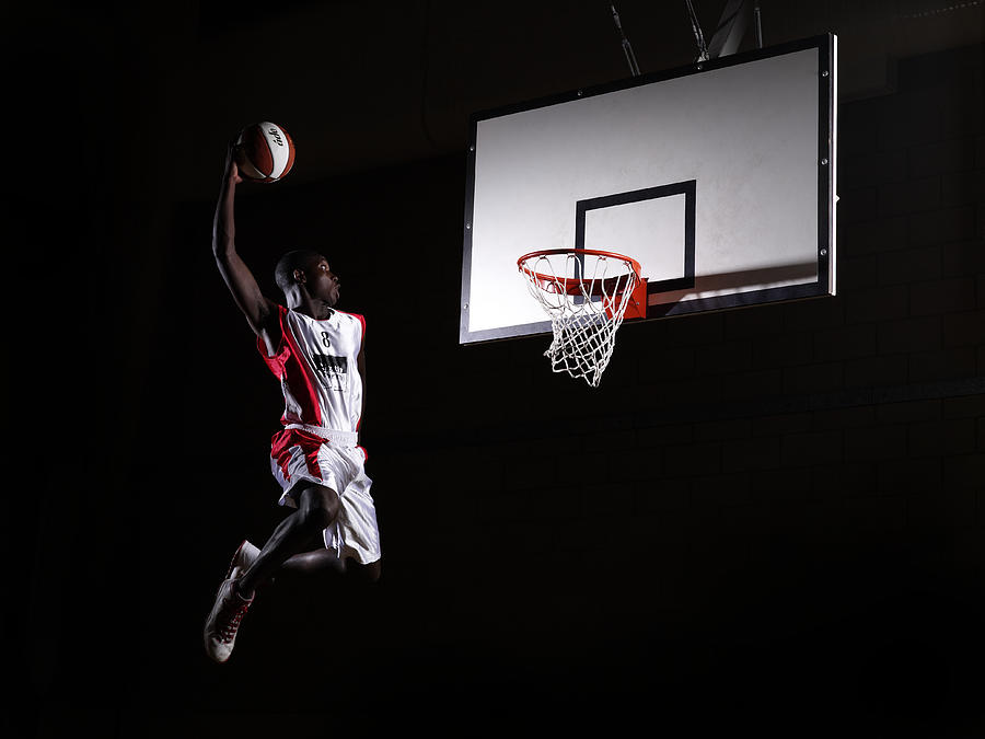 Young Man In The Air About To Dunk The Photograph by Compassionate Eye Foundation/steve Coleman/ojo Images Ltd