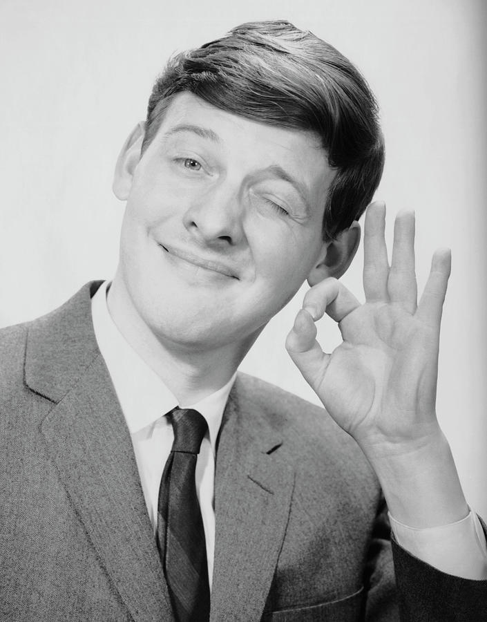 Young Man Making The O.k. Sign Photograph by George Marks