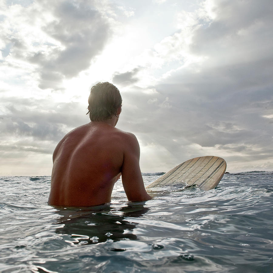 Young Man On Surfboard In Water Looking Photograph by Siri Stafford