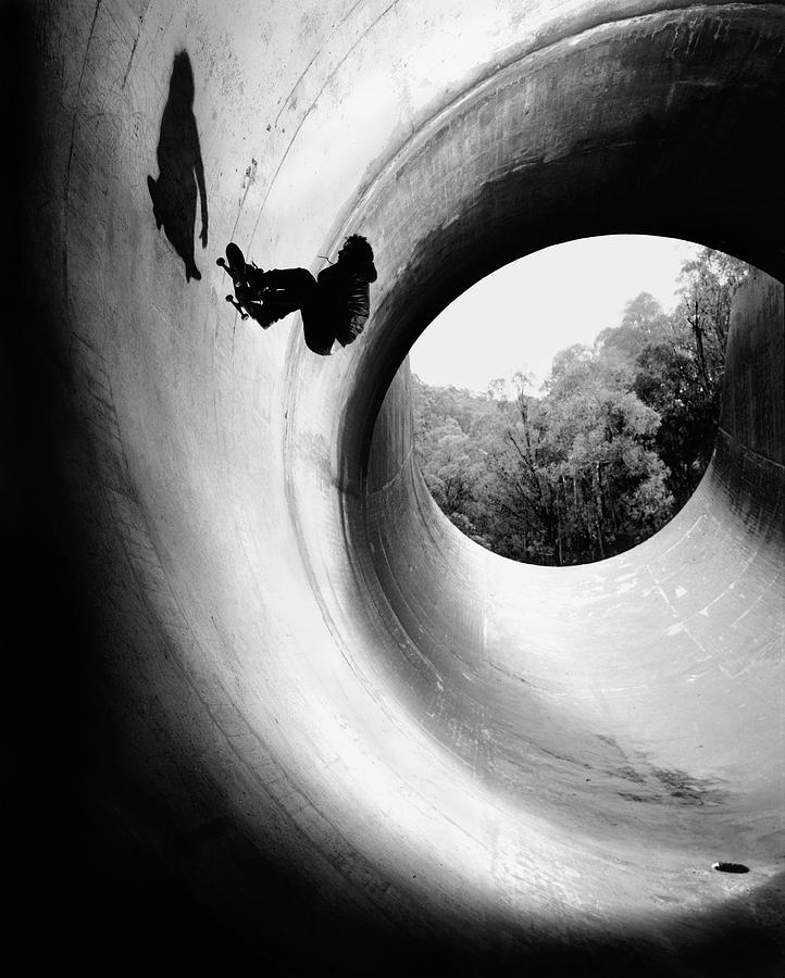 Young Man Skateboarding In Full Pipe Photograph by Kirk Edwards