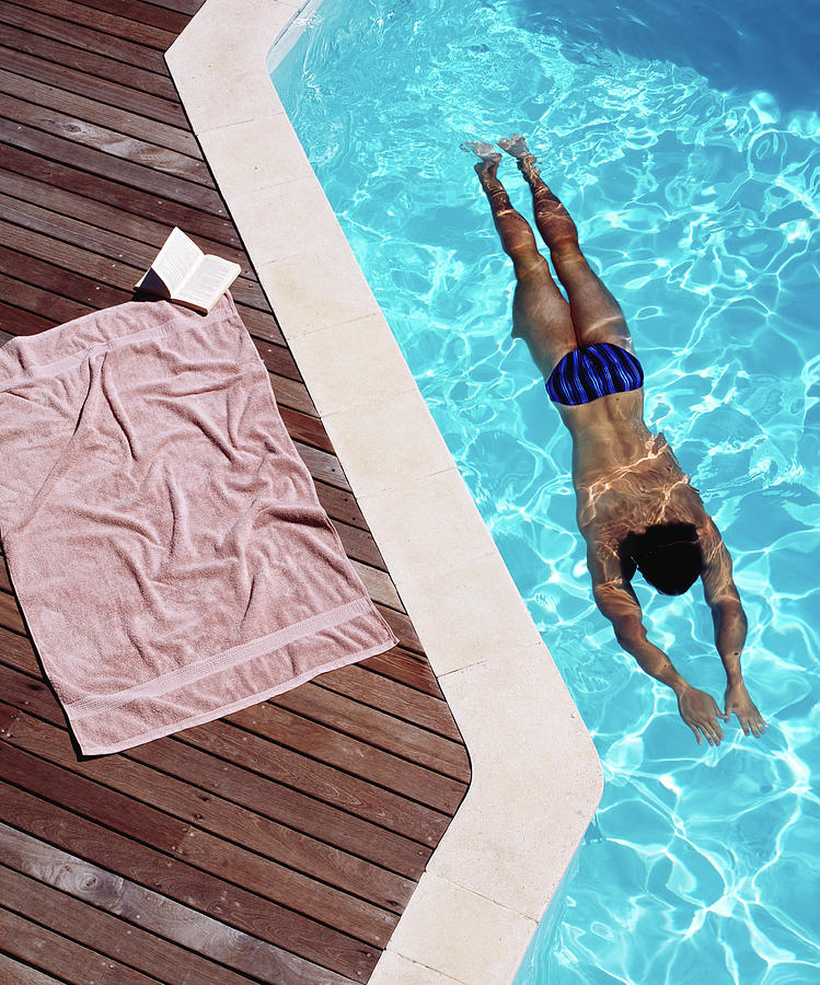 Young Man Swimming, Towel And Book At Photograph by Kelvin Murray