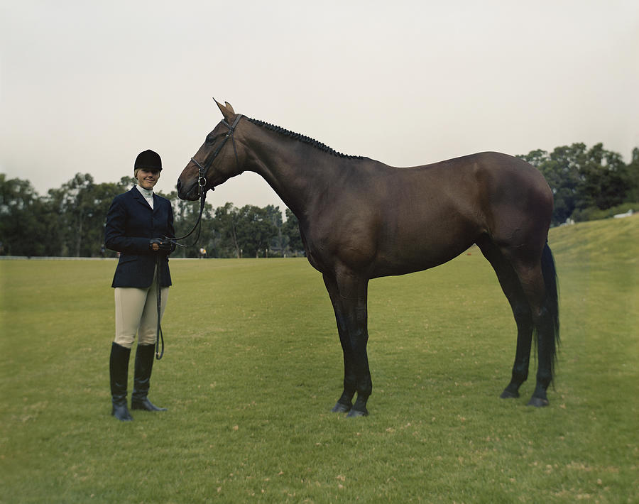 Young With Horse Standing On Field Photograph by Tom Kelley Archive