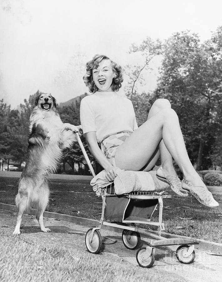 Caucasian Photograph - Young Woman And Her Pushy Pet Dog by Everett Collection