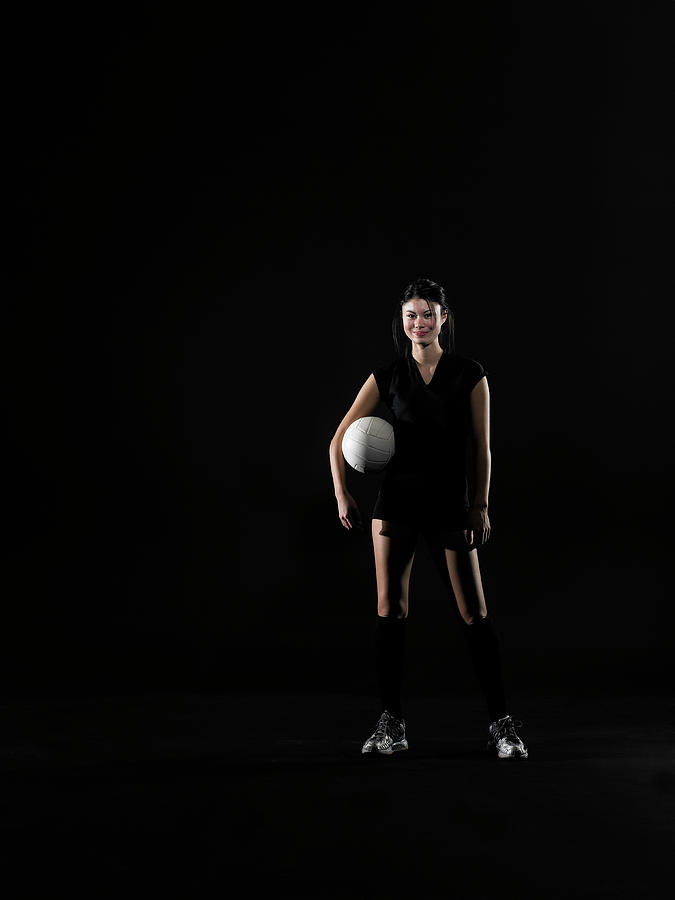 Young Woman Holding Volleyball, Portrait Photograph by Thomas Barwick