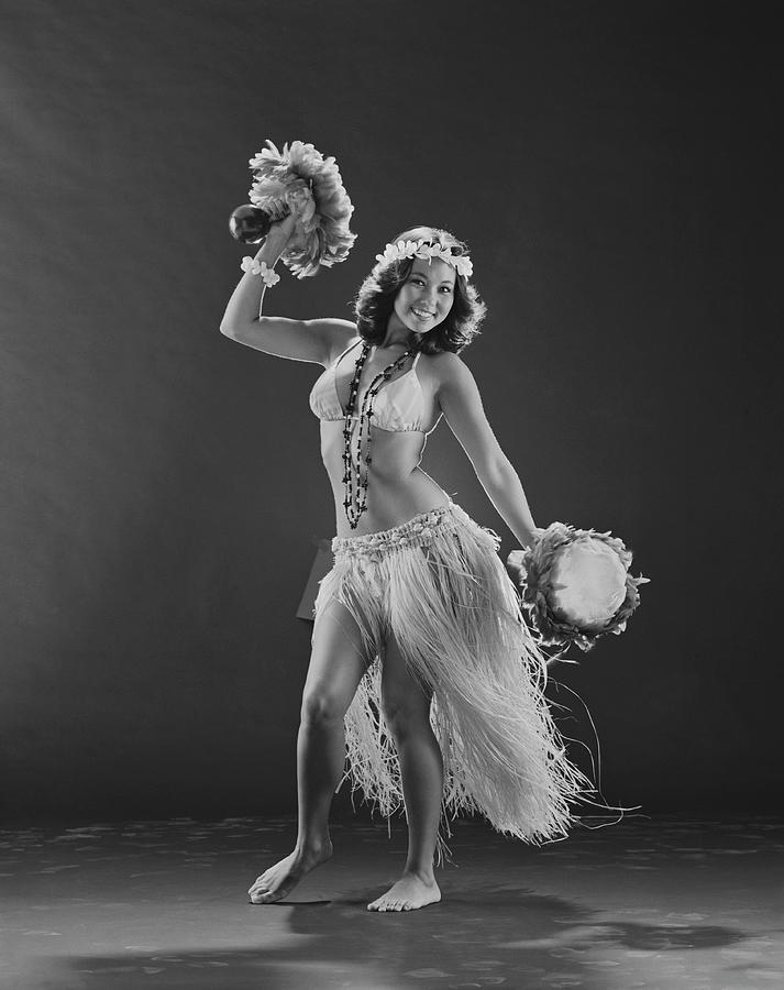 Young Woman Hula Dancer With Feathered Photograph by Tom Kelley Archive