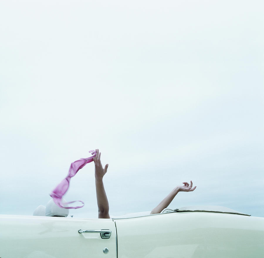 Young Woman In Convertible Car, Arms Photograph by Jerome Tisne