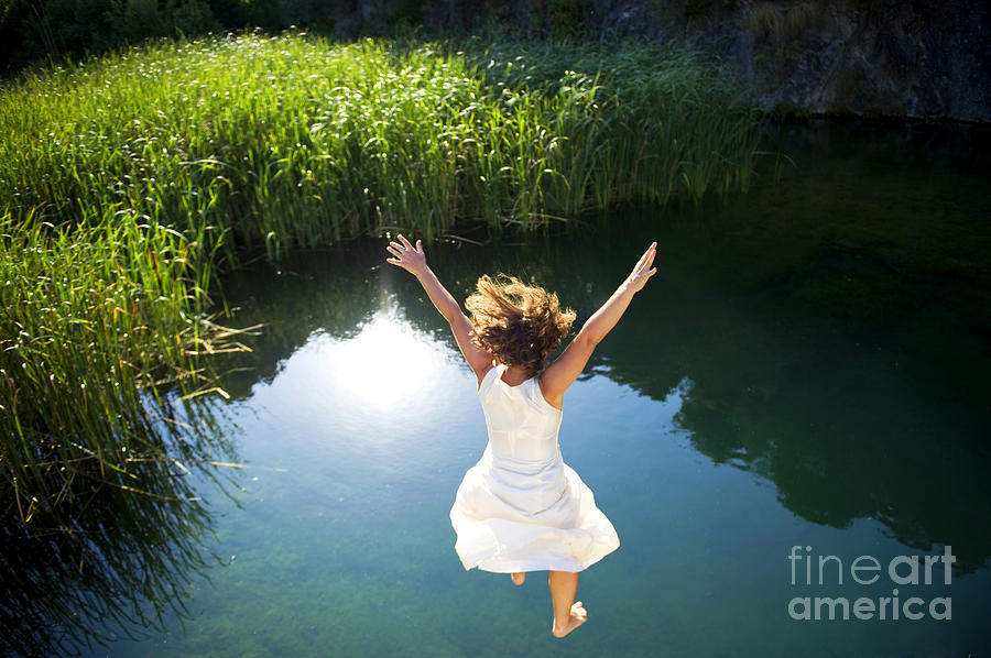Bride Photograph - Young Woman In White Dress Jumping Into by Luna Vandoorne