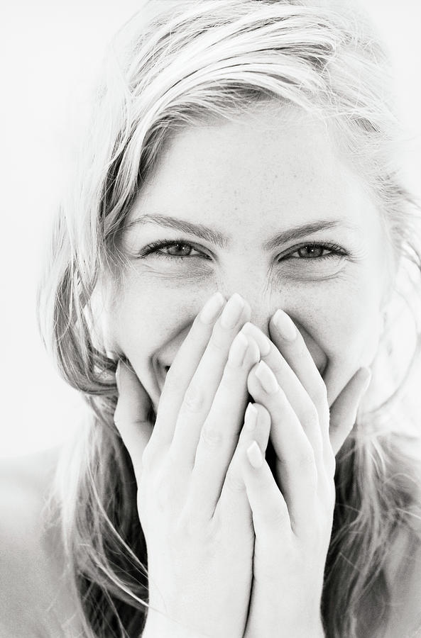 Young Woman Laughing, Hands Over Mouth Photograph by Pando Hall
