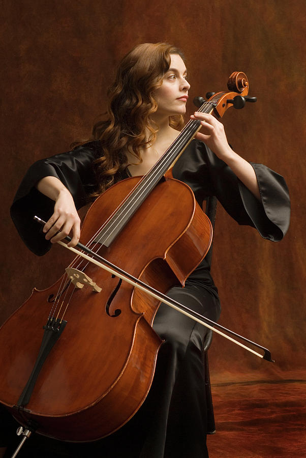 Young Woman Playing Cello Photograph by Pm Images