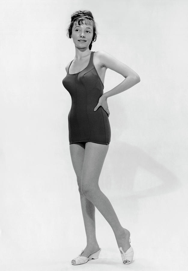 Young Woman Poses In Bathing Suit Photograph by George Marks