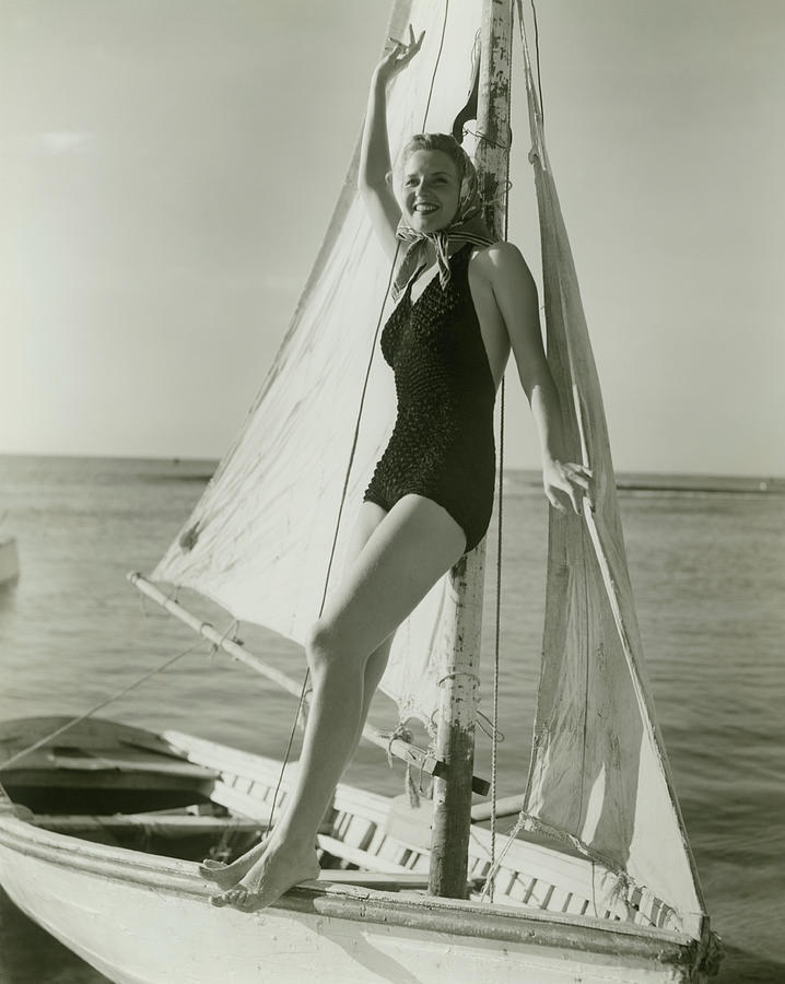 Young Woman Posing On Sailboat Photograph by George Marks