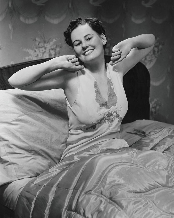 Young Woman Stretching In Bed, B&w Photograph by George Marks