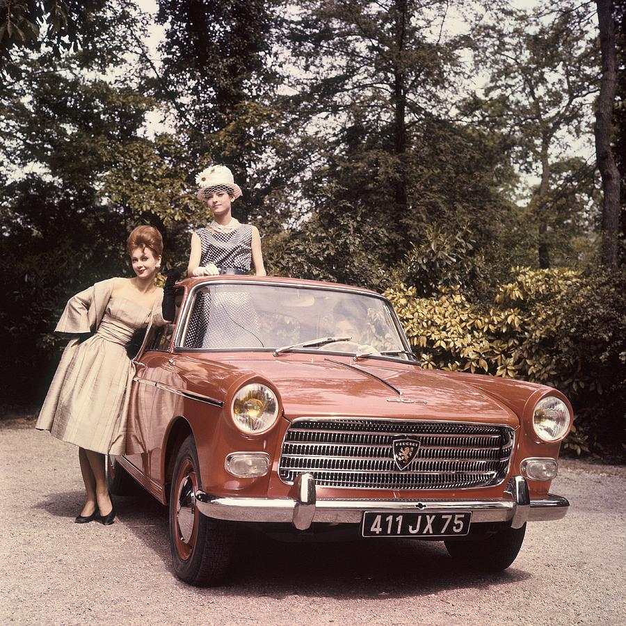 Young Women Presenting The New Peugeot Photograph by Keystone-france