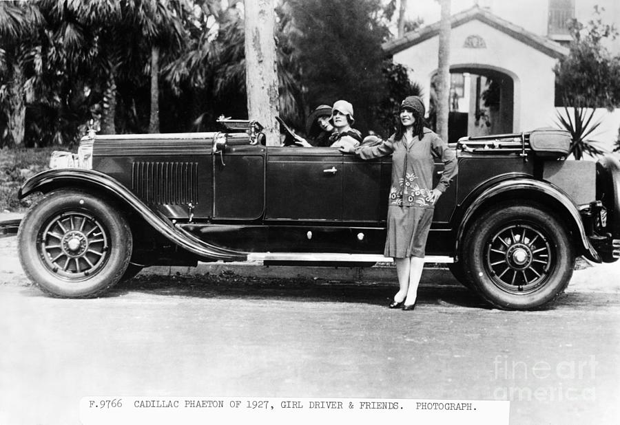 Young Women With 1927 Cadillac Phaeton Photograph by Bettmann