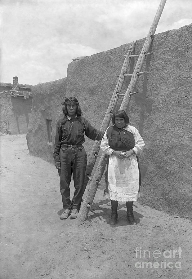 Zuni Couple In Front Of Adobe Home Photograph by Bettmann