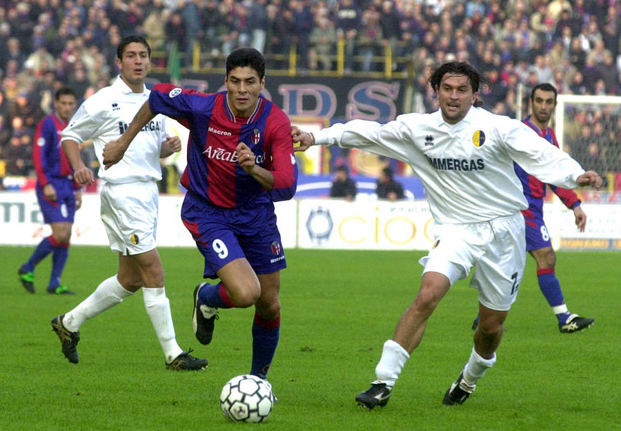 Julio Cruz of Bologna and Omar Milanetto of Modena in action... Photograph by Getty Images
