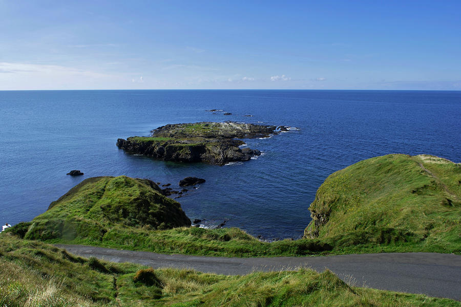 Headland Photograph - At Niarbyl Point by Steve Watson