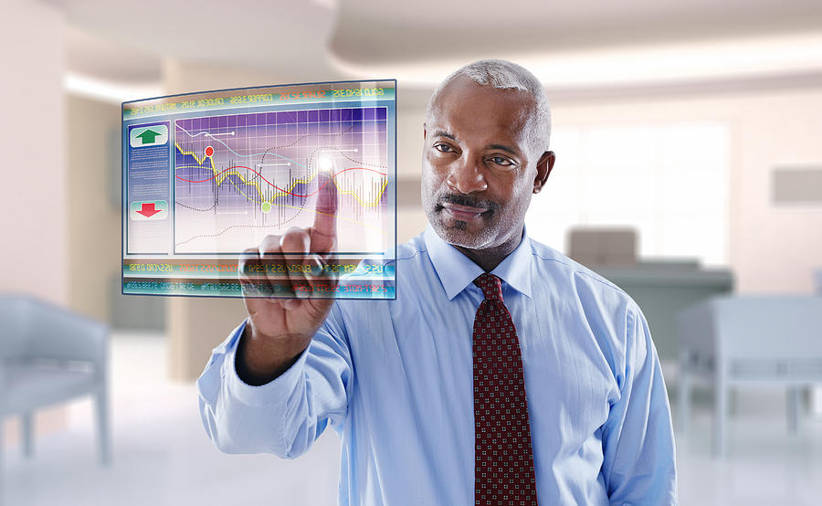 Black businessman using digital display Photograph by MixAll Studio