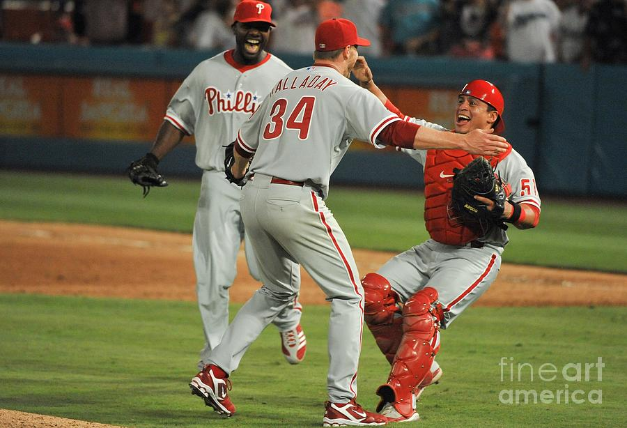 Carlos Ruiz, Ryan Howard, and Roy Halladay Photograph by Ronald C. Modra