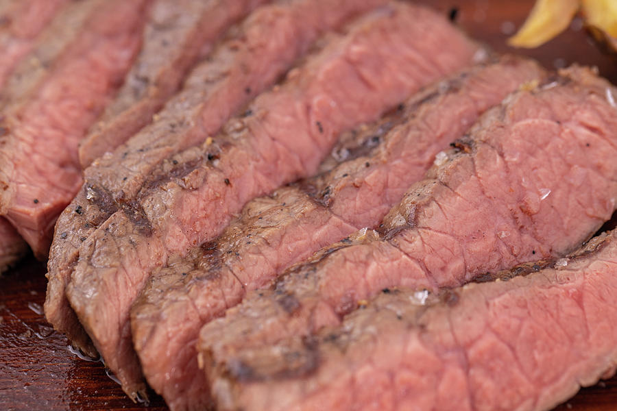 Close Up Sliced Steak.  Delicious Steak On Wooden Board. Photograph