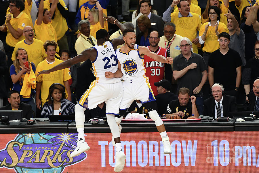 Draymond Green and Stephen Curry Photograph by Garrett Ellwood