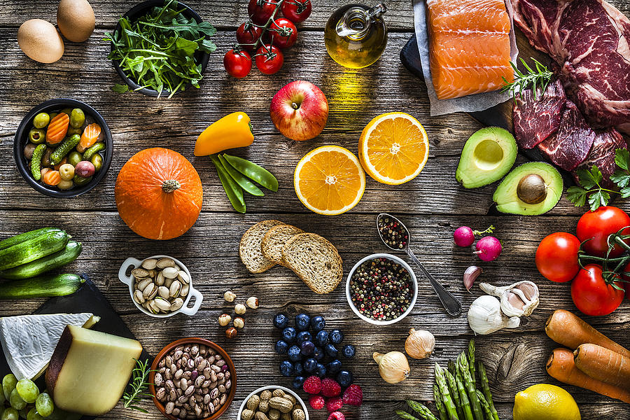 Food backgrounds: table filled with large variety of food Photograph by Fcafotodigital