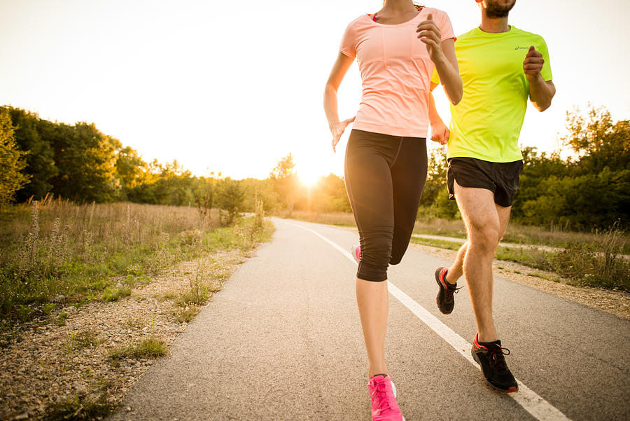 Friends jogging at sunset Photograph by Martin Novak