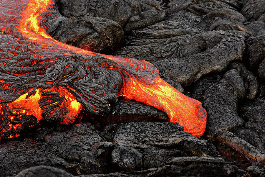 Lava Photograph - Glowing lava emerges from a column of the earth by Ralf Lehmann