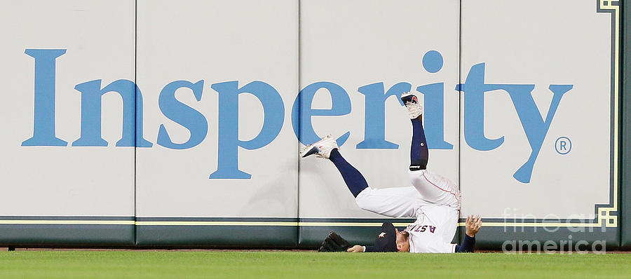 Khris Davis And George Springer Photograph by Bob Levey