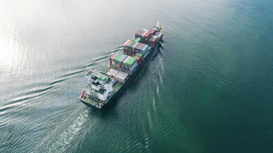 Large Container Ship At Sea. Aerial Top View Of Cargo Container Ship Vessel Import Export Container Sailing. Photograph
