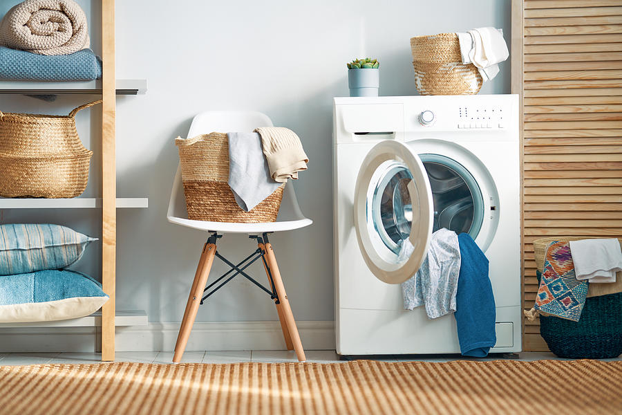 Laundry Room With A Washing Machine Photograph by Choreograph