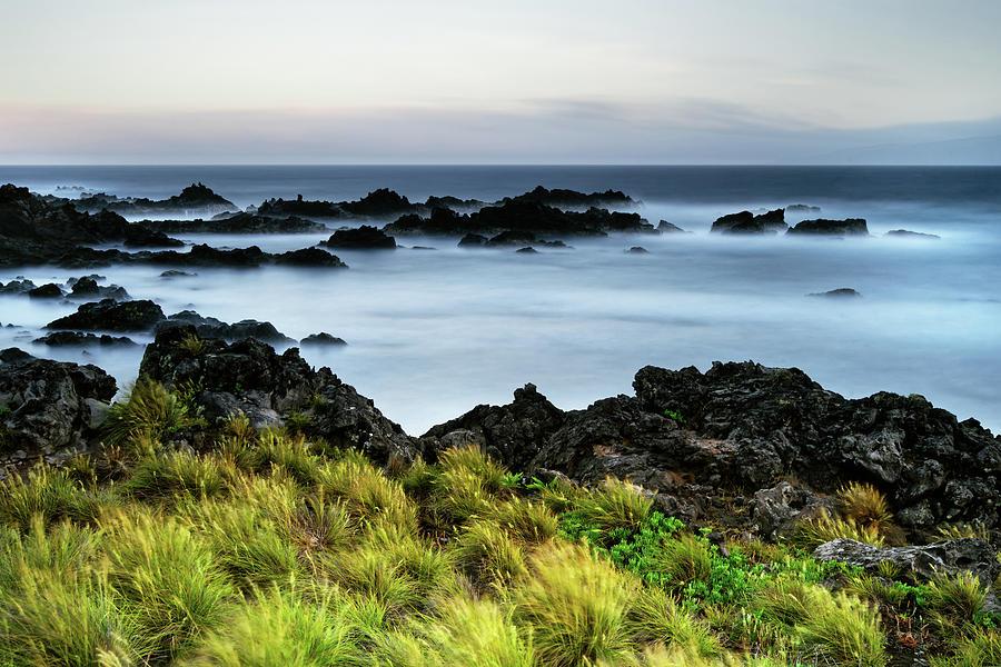 Coast Photograph - Lonely beach of the Azores island Corvo by Ralf Lehmann
