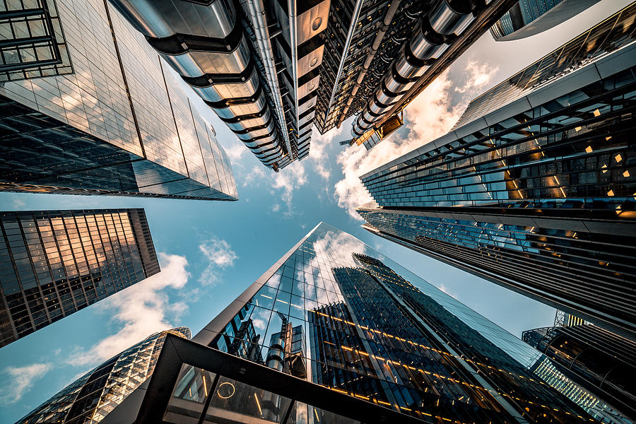 Looking directly up at the skyline of the financial district in central London - stock image Photograph by Nikolay Pandev