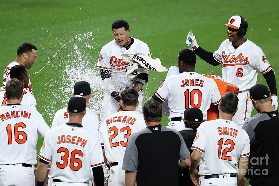 Manny Machado, Jonathan Schoop, and Adam Jones Photograph by Rob Carr