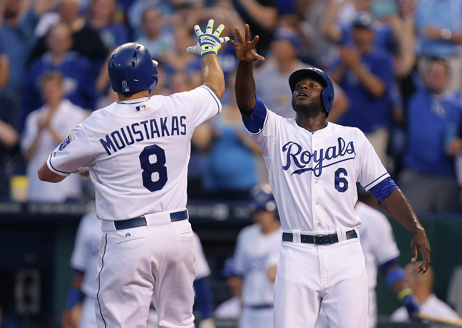 Mike Moustakas And Lorenzo Cain Photograph by Ed Zurga