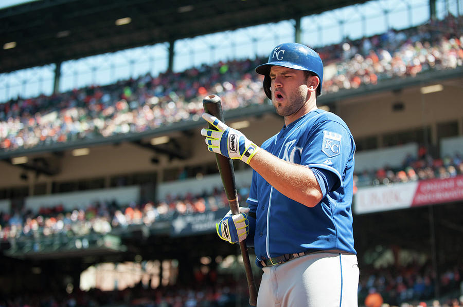 Mike Moustakas Photograph by Rob Tringali